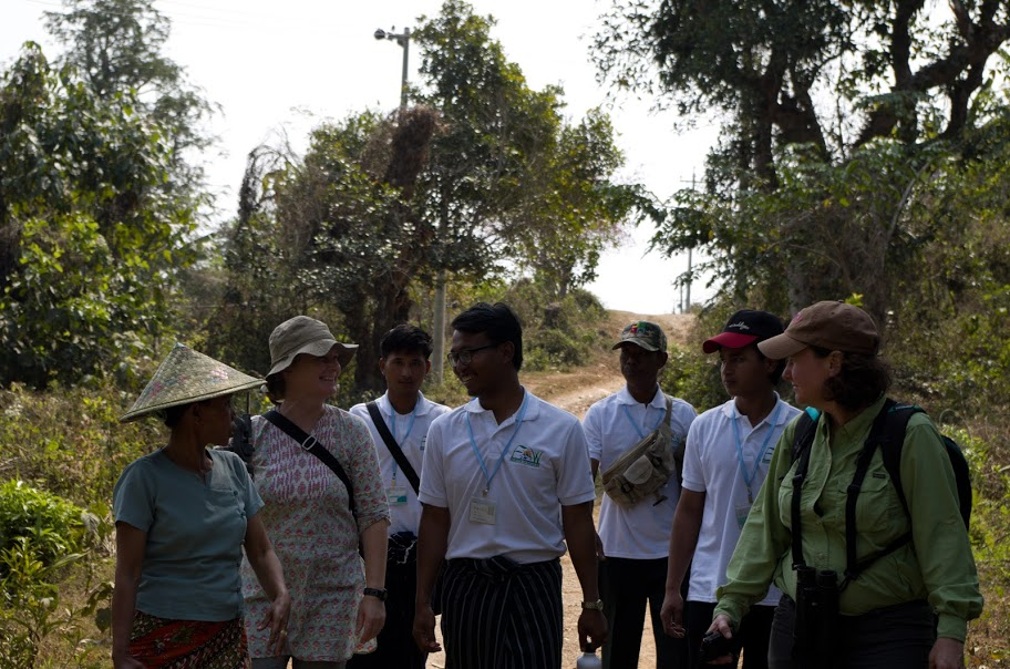 Group of people walking outdoors and talking and laughing together in Myanmar
