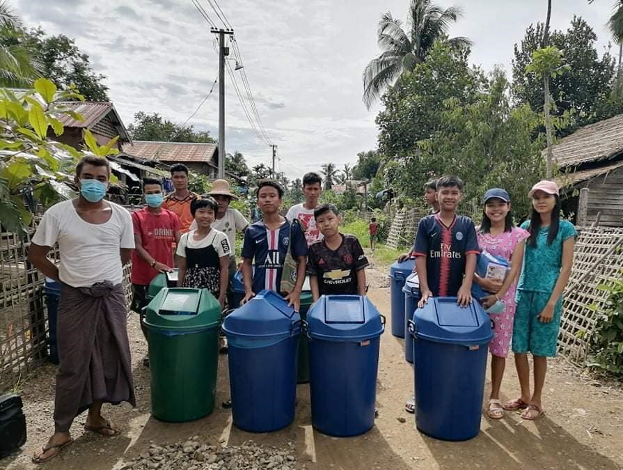 villagers cleaning up plastic waste